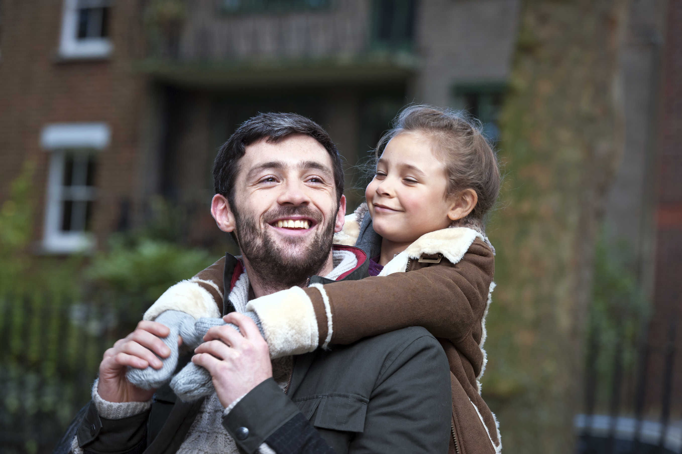 happy white father and daugther hugging