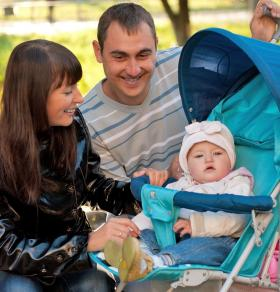 Young family with baby in stroller