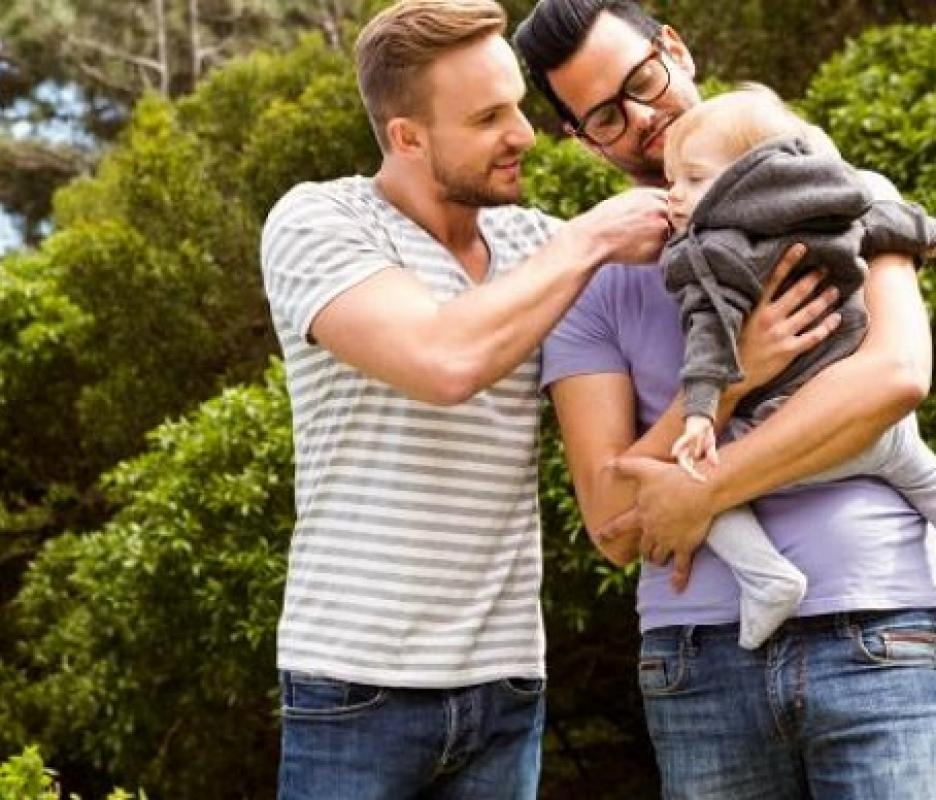 Two dads couple with child