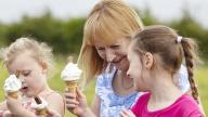 Mum and two girls outdoors with ice creams