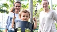 Same sex female couple with child in swing