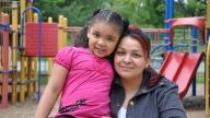Hispanic mother hugging her daughter