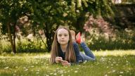 girl laying in the grass
