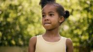 Black girl wearing yellow vest