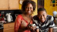 Black mum and teenage boy at home